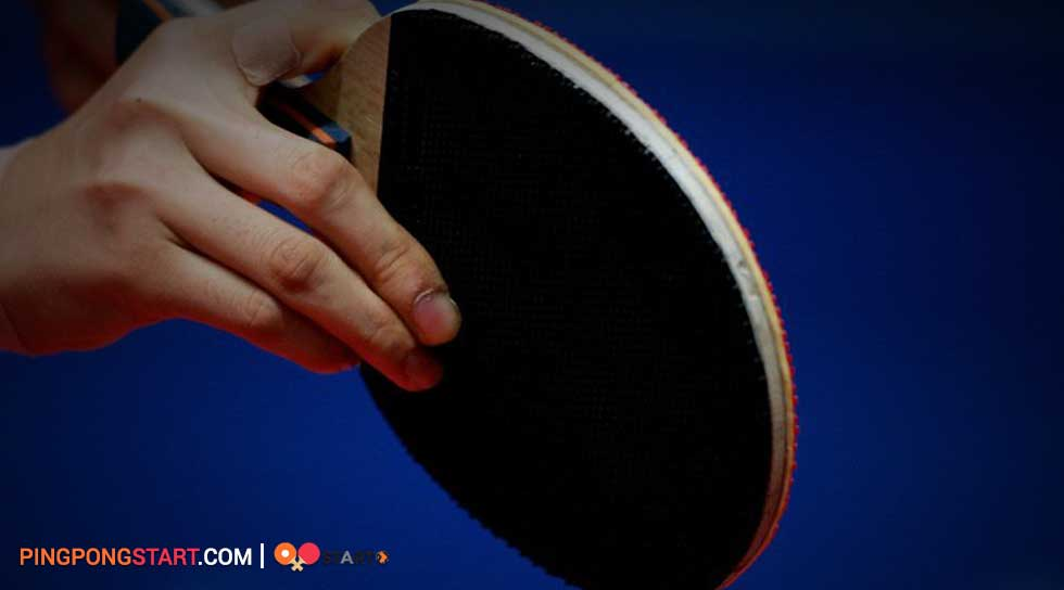 hold ping pong paddle